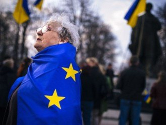 "An elderly woman wrapped with an European Union flag attends a pro-Ukraine rally in the eastern Ukrainian city of Lugansk on April 15, 2014. Russia's foreign minister on April 15 warned Kiev against using force to quell pro-Moscow separatists in eastern Ukraine, saying the ""criminal"" act would undermine talks planned in Geneva. Ukraine's Western-backed leader on April 15 accused Russia of trying to enflame the country's southeast but said he would proceed cautiously against pro-Kremlin militias consolidating control in the volatile region.AFP PHOTO / DIMITAR DILKOFFDIMITAR DILKOFF/AFP/Getty Images"