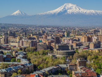 Mount Ararat and the Yerevan skyline. The Opera house is visible in the center.